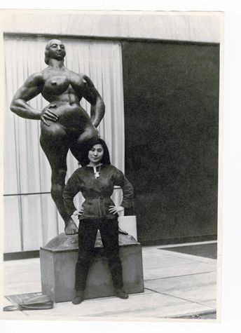 Yoko Ono with Standing Woman (1932) by Gaston Lachaise, The Museum of Modern Art Sculpture Garden, New York. c. 1960–61. Photograph by Minoru Niizuma © Minoru Niizuma/Courtesy Lenono Photo Archive, New York.