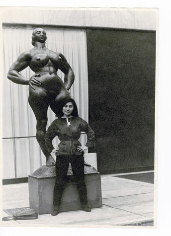 Yoko Ono with Standing Woman (1932) by Gaston Lachaise, The Museum of Modern Art Sculpture Garden, New York. c. 1960–61. Photograph by Minoru Niizuma © Minoru Niizuma/Courtesy Lenono Photo Archive, New York.