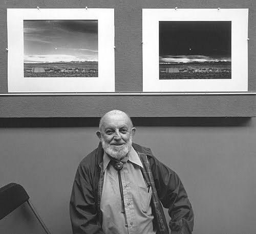"Ansel Adams with the straight print [as it came out of the camera] side-by-side with the finished print of ""Moonrise."""